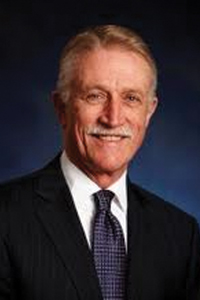 Former Joy Global President and CEO Michael W. Sutherlin