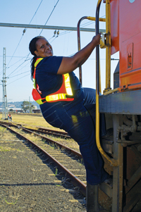 A driver boards a locomotive at Vryheid rail yard, where the Songololo coal line begins its journey to the coast. (Photo credit: Pierre Crocquet)