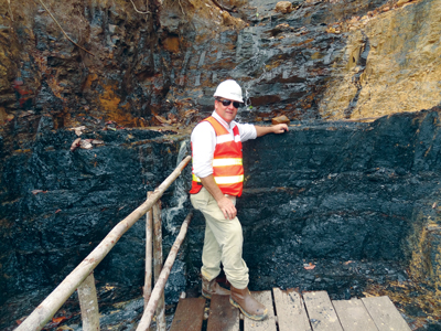 Cokal Chairman Peter Lynch in front of an outcrop of coking coal at the BBM  project. Cokal expects production at BBM to start in early 2015.