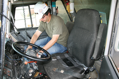 A NIOSH researcher installing data collection instrumentation in a haul truck.