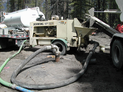 A mixer (center) is used to combine water, overburden and chemical additives, with the resulting paste being pumped underground to prevent the collapse of underground coal workings in Canmore, Alberta