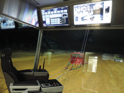This is not a simulator; it's a nighttime photo taken from inside a completely upgraded operator's cabin.