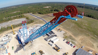 The dragline features a 57-ft diameter roller circle and a 320-ft boom with a 290-ft operating radius at a 38° angle.