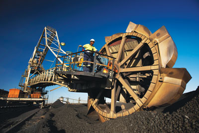 A stacker/reclaimer at BHP Billiton's Klipspruit colliery; the mine is one of the assets being spun off into a new company.(Photo credit: BHP Billiton)