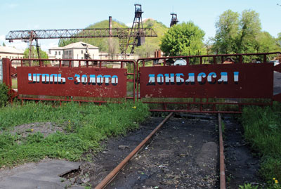 "The gate of one of the coal mines in Donetsk Oblast. The sign translates to ""Coal is the gold of Donbass."" (Photo credit: coal mine Belozerskay)"