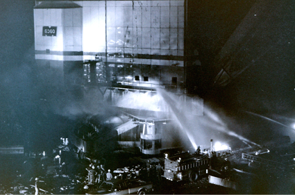 The fire on the night of September 9, 1991, that destroyed the Captain. The firefighting vehicles in the foreground are on a bench some 25 ft above the pit floor on which the shovel is standing. (Photo with special permission, Copyright 1992, J. Monroe)